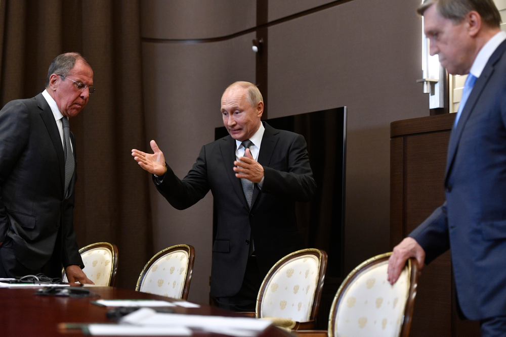 Russian President Vladimir Putin, center, welcomes Russian Foreign Minister Sergey Lavrov, left, and Kremlin foreign policy aide Yuri Ushakov for the talks with U.S. Secretary of State Mike Pompeo, during their meeting in the Black Sea resort city of Sochi, southern Russia, Tuesday, May 14, 2019. Pompeo arrived in Russia for talks that are expected to focus on an array of issues including arms control and Iran. (Alexander Nemenov/Pool Photo via AP)