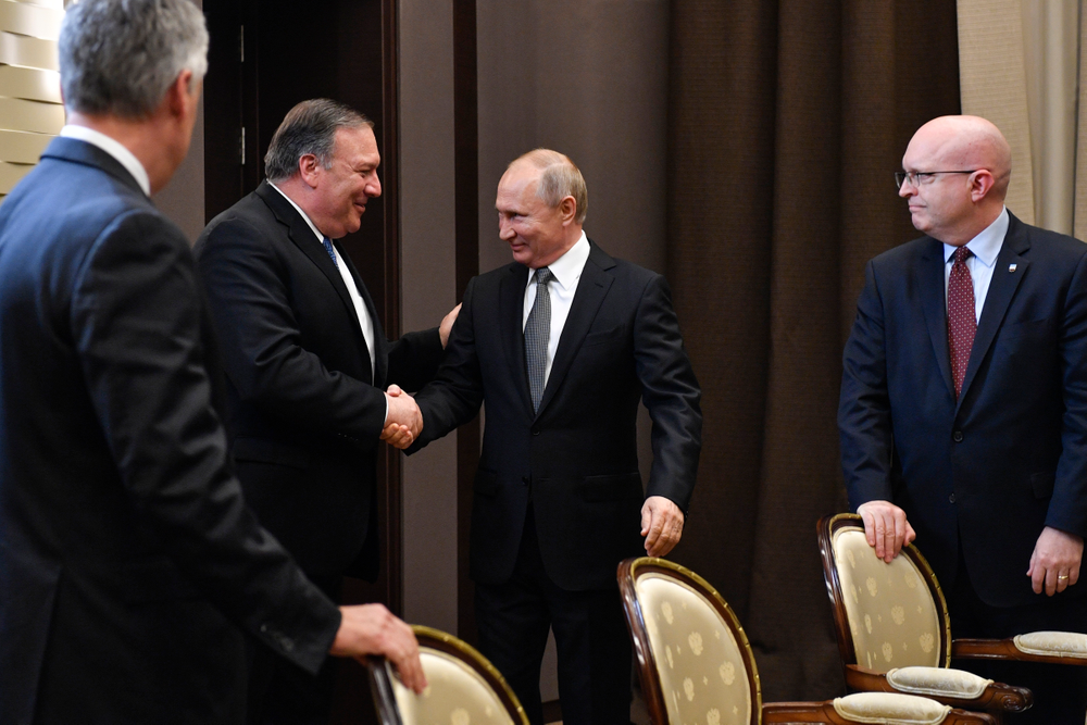 Russian President Vladimir Putin, second right, and U.S. Secretary of State Mike Pompeo, second left, greet each other prior to their talks in the Black Sea resort city of Sochi, southern Russia, Tuesday, May 14, 2019. Pompeo arrived in Russia for talks that are expected to focus on an array of issues including arms control and Iran. (Alexander Nemenov/Pool Photo via AP)