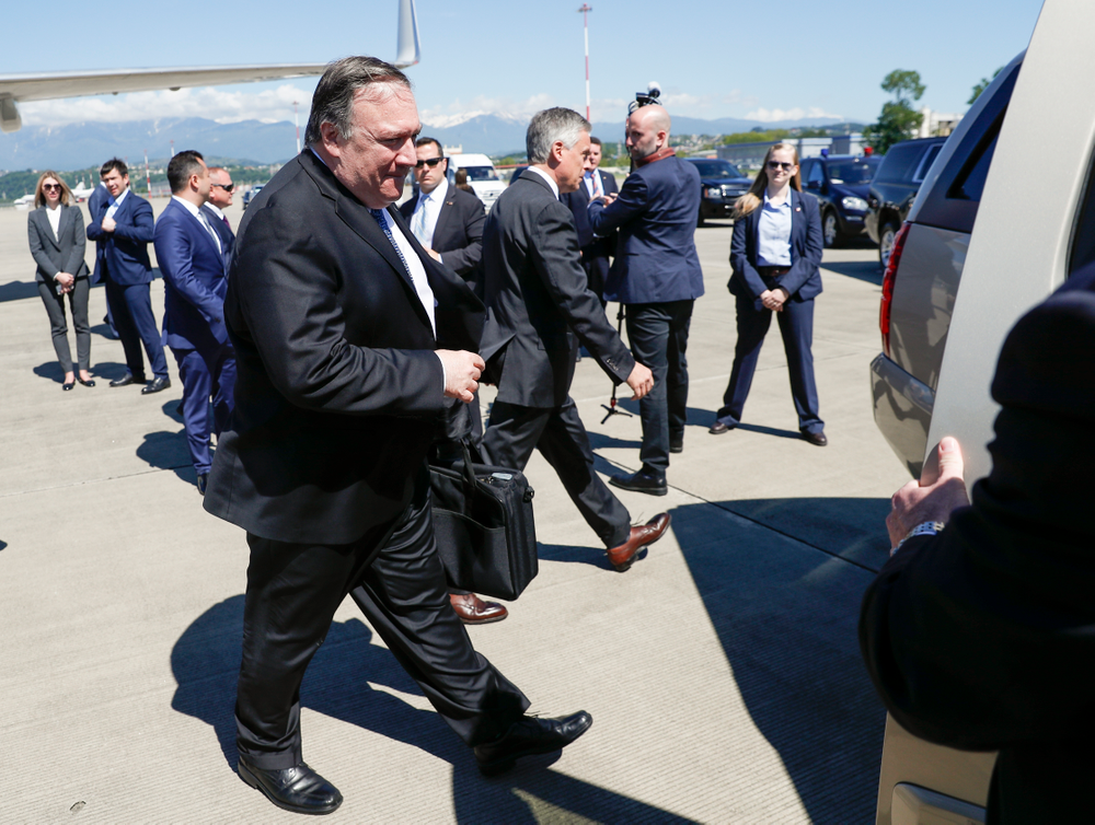 U.S. Secretary of State Mike Pompeo walks from the plane upon his arrival at the airport in the Black Sea resort city of Sochi, southern Russia, Tuesday, May 14, 2019. Pompeo's first trip to Russia starts Tuesday in Sochi, where he and Russian Foreign Minister Sergey Lavrov are sitting down for talks and then having a joint meeting with President Vladimir Putin. (AP Photo/Pavel Golovkin, Pool)