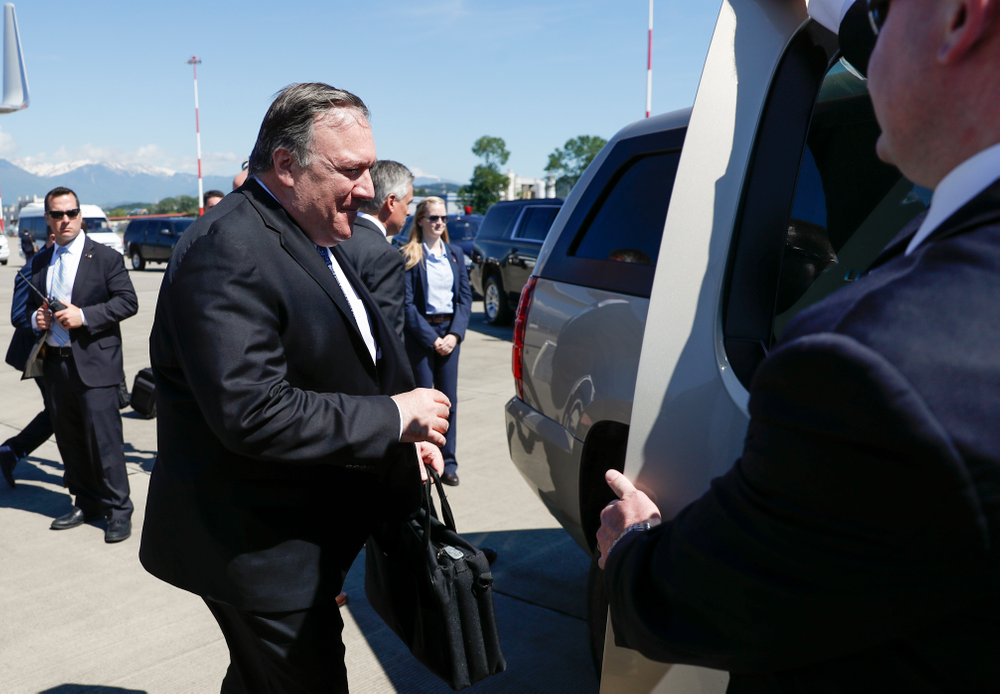 U.S. Secretary of State Mike Pompeo takes a limousine upon his arrival at the airport in the Black Sea resort city of Sochi, southern Russia, Tuesday, May 14, 2019. Pompeo's first trip to Russia starts Tuesday in Sochi, where he and Russian Foreign Minister Sergey Lavrov are sitting down for talks and then having a joint meeting with President Vladimir Putin. (AP Photo/Pavel Golovkin, Pool)
