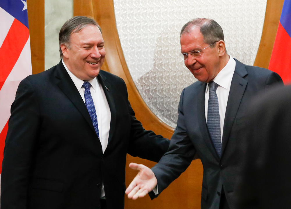 Russian Foreign Minister Sergey Lavrov, right, welcomes U.S. Secretary of State Mike Pompeo for the talks in the Black Sea resort city of Sochi, southern Russia, Tuesday, May 14, 2019. Pompeo's first trip to Russia starts Tuesday in Sochi, where he and Russian Foreign Minister Sergey Lavrov are sitting down for talks and then having a joint meeting with President Vladimir Putin. (AP Photo/Pavel Golovkin, Pool)
