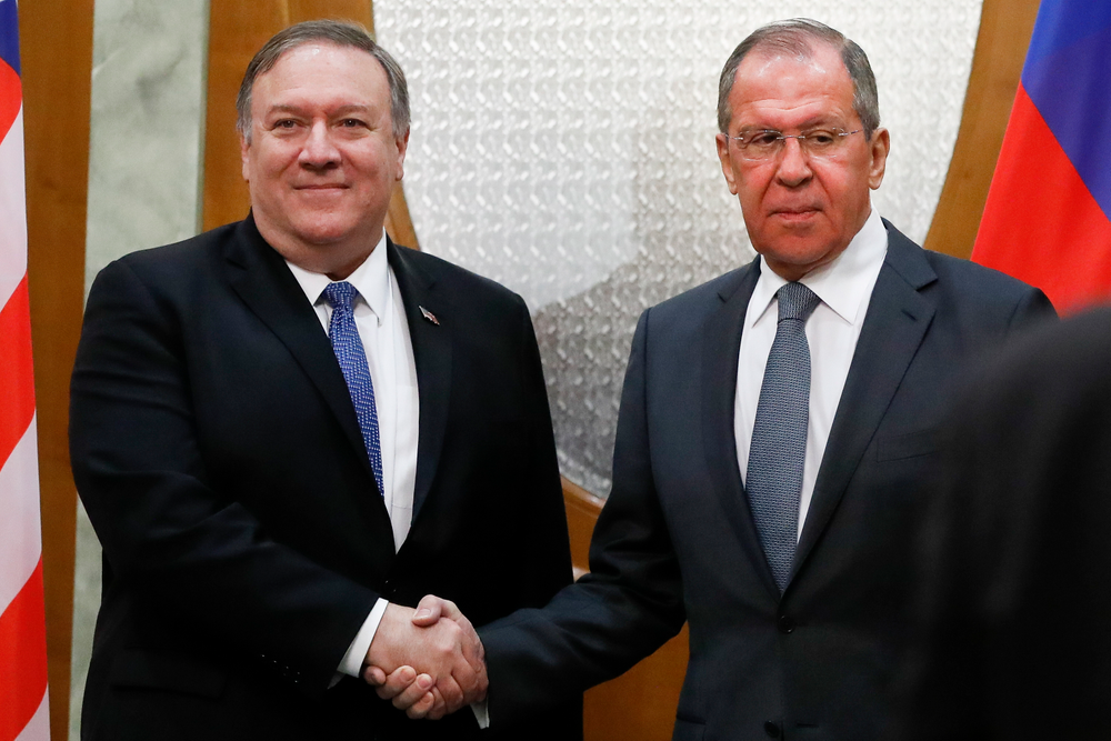 U.S. Secretary of State Mike Pompeo, left, and Russian Foreign Minister Sergey Lavrov shake hands prior to their talks in the Black Sea resort city of Sochi, southern Russia, Tuesday, May 14, 2019. Pompeo's first trip to Russia starts Tuesday in Sochi, where he and Russian Foreign Minister Sergey Lavrov are sitting down for talks and then having a joint meeting with President Vladimir Putin. (AP Photo/Pavel Golovkin, Pool)