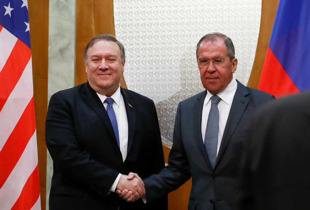U.S. Secretary of State Mike Pompeo, left, and Russian Foreign Minister Sergey Lavrov pose for a photo prior to their talks in the Black Sea resort city of Sochi, southern Russia, Tuesday, May 14, 2019. Pompeo's first trip to Russia starts Tuesday in Sochi, where he and Russian Foreign Minister Sergey Lavrov are sitting down for talks and then having a joint meeting with President Vladimir Putin. (AP Photo/Pavel Golovkin, Pool)