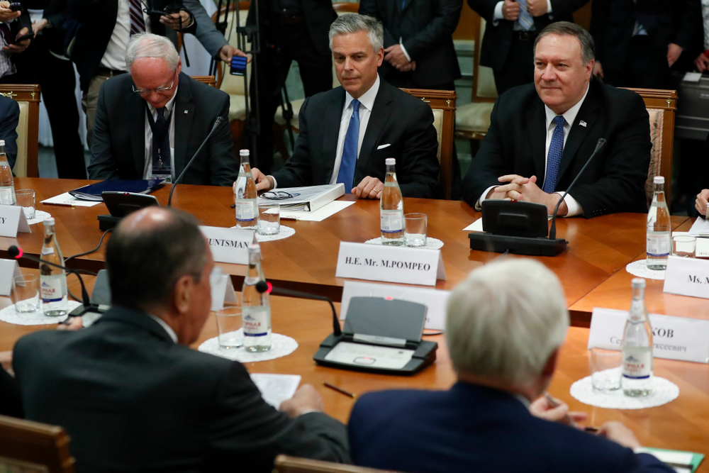 U.S. Secretary of State Mike Pompeo, right, and U.S. Ambassador to Russia Jon Huntsman, second left, listen to Russian Foreign Minister Sergey Lavrov, left, back to a camera, during their talks in the Black Sea resort city of Sochi, southern Russia, Tuesday, May 14, 2019. Pompeo's first trip to Russia starts Tuesday in Sochi, where he and Russian Foreign Minister Sergey Lavrov are sitting down for talks and then having a joint meeting with President Vladimir Putin. (AP Photo/Pavel Golovkin, Pool)