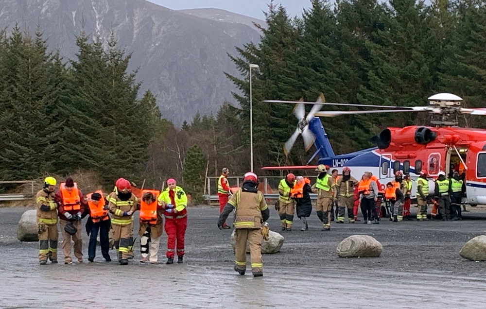 Passengers rescued from the Viking Sky cruise ship are helped from a helicopter in Hustadvika, Norway, Saturday March 23, 2019. A cruise ship with engine problems sent a mayday call off Norway's western coast on Saturday, then began evacuating its 1,300 passengers and crew amid stormy seas and heavy winds in a high-risk helicopter rescue operation. (Odd Roar Lange/NTB Scanpix via AP)