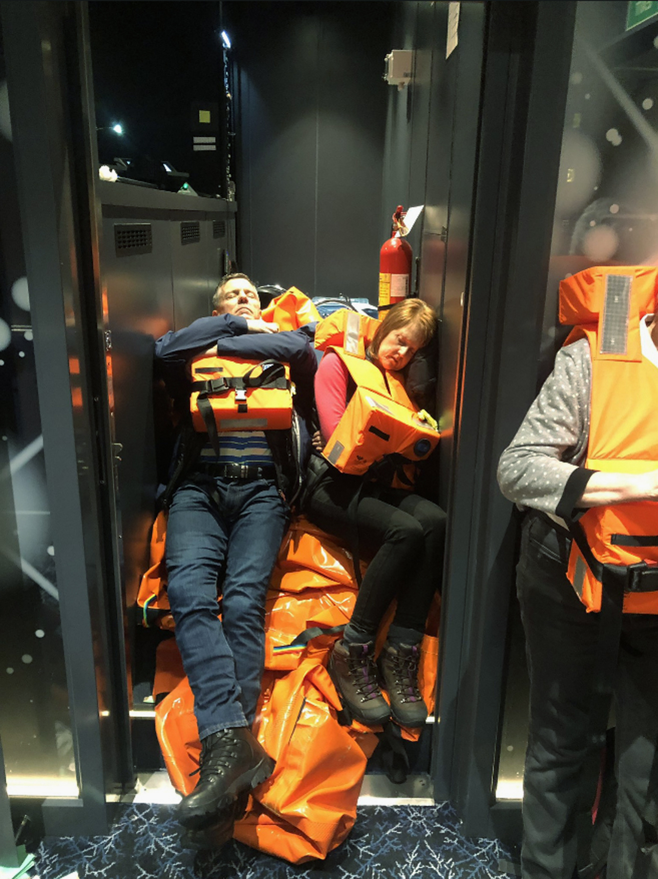 This photo provided by Alexus Sheppard shows passengers on board the Viking Sky, waiting to be evacuated, off the coast of Norway on Saturday, March 23, 2019. Rescue workers off Norway's western coast rushed to evacuate 1,300 passengers and crew from a disabled cruise ship by helicopter on Saturday, winching them one-by-one to safety as heaving waves tossed the ship from side to side and high winds battered the operation. (Alexus Sheppard via AP)