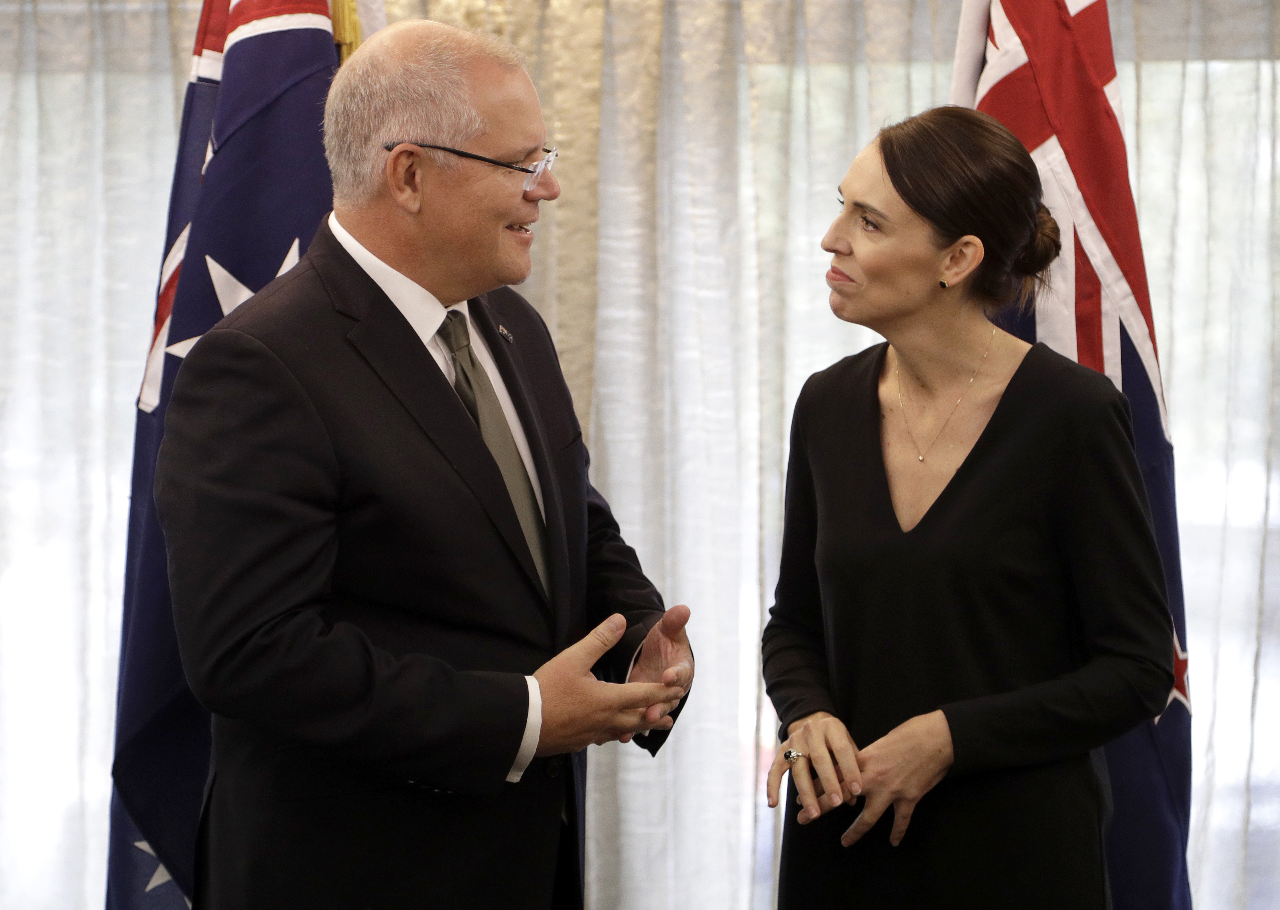 New Zealand Prime Minister Jacinda Ardern, right, talks with Australian Prime Minister Scott Morrison at a bilateral meeting following a national remembrance service for the victims of the March 15 mosques terrorist attack in Christchurch, New Zealand, Friday, March 29, 2019. (AP Photo/Mark Baker, Pool)