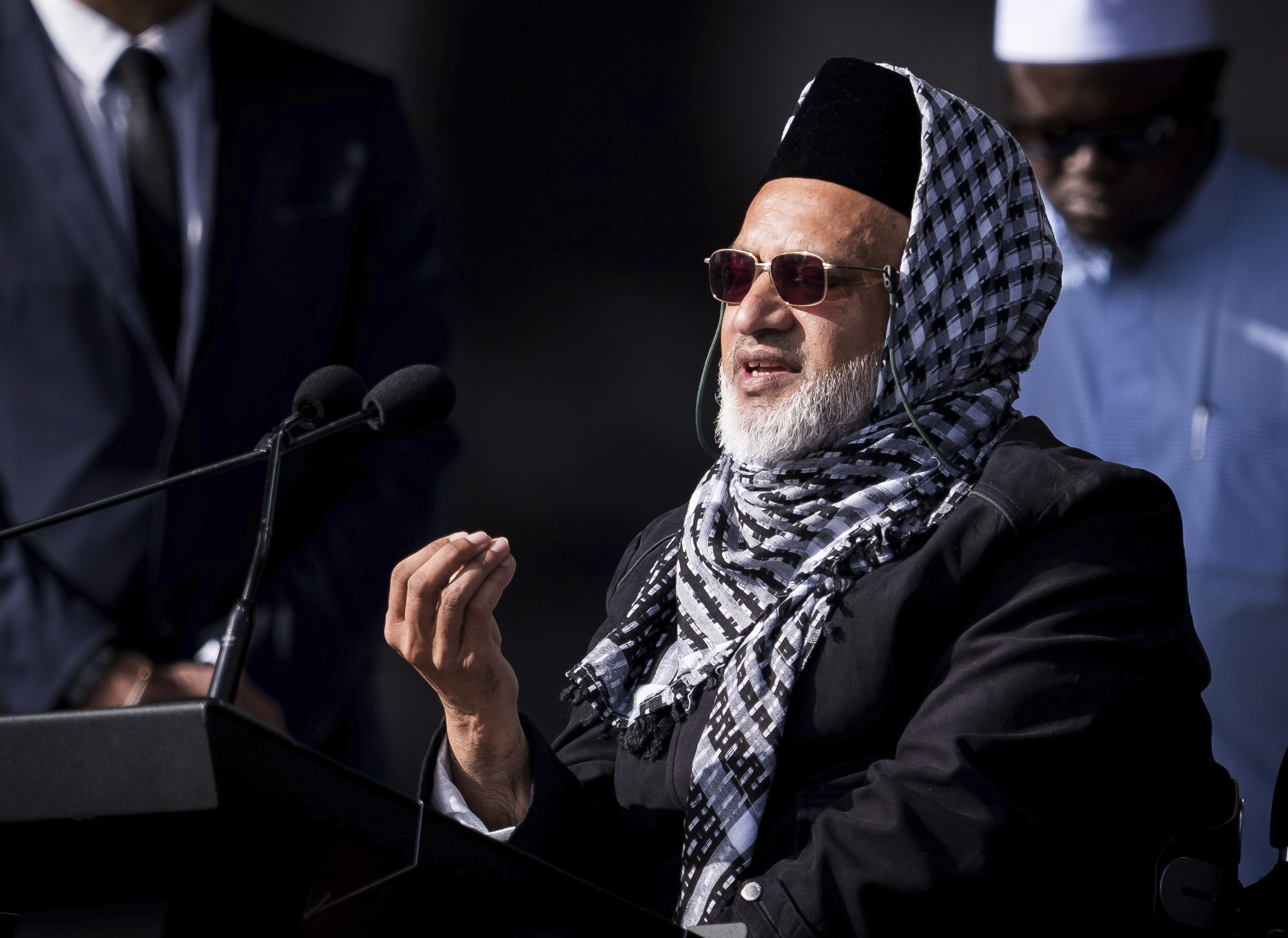 In this photo supplied by the New Zealand government, Mosque shooting survivor Farid Ahmed addresses the national remembrance service in Hagley Park for the victims of the March 15 mosques terrorist attack in Christchurch, New Zealand, Friday, March 29, 2019. (Mark Tantrum/New Zealand Government via AP)