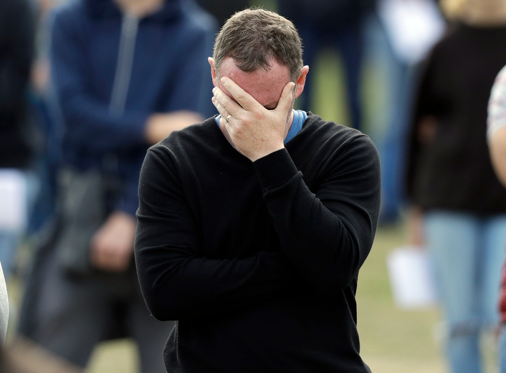 A man reacts during a national remembrance service in Hagley Park for the victims of the March 15 mosque terrorist attack in Christchurch, New Zealand, Friday, March 29, 2019. (AP Photo/Mark Baker)