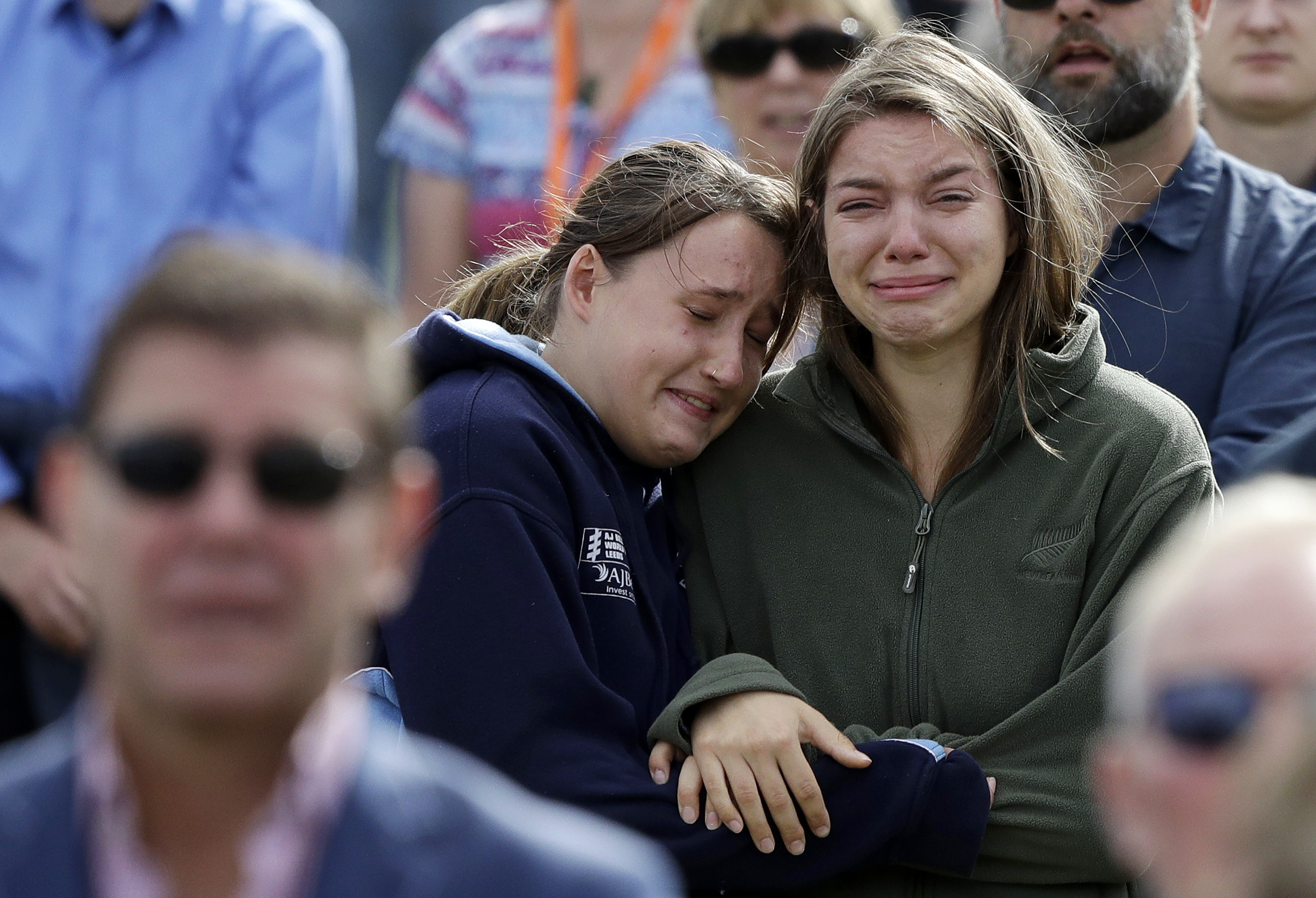 In this Friday, March 29, 2019, file photo, women react as the New Zealand national anthem is sung during a national remembrance service in Hagley Park for the victims of the March 15 mosque terrorist attack in Christchurch, New Zealand. (AP Photo/Mark Baker, File)