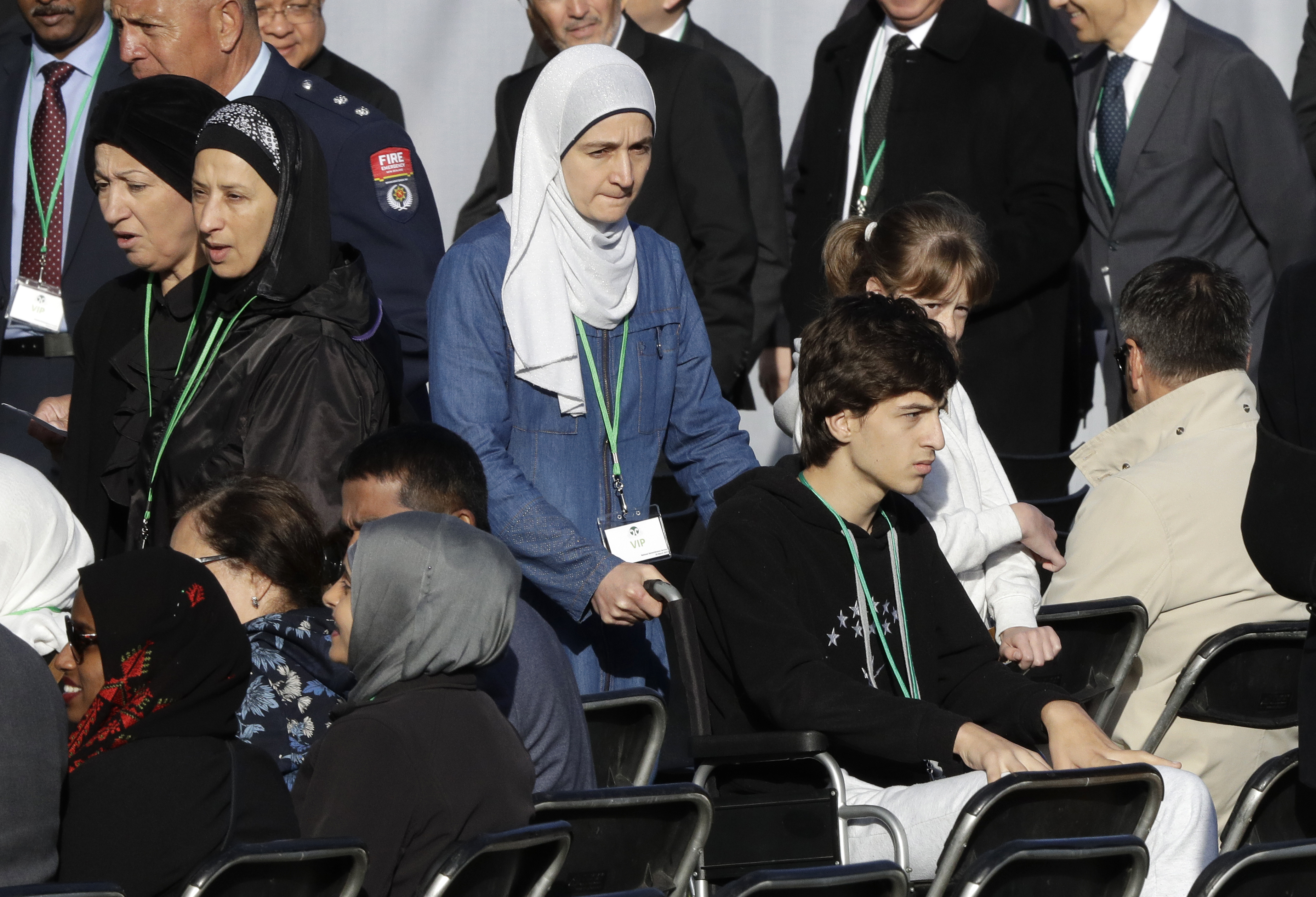 Mosque shooting survivor Zaid Mustafa, in wheelchair arrives with his mother to the National Remembrance Service in Hagley Park for the victims of the March 15 mosques terrorist attack in Christchurch, New Zealand, Friday, March 29, 2019. (AP Photo/Mark Baker)