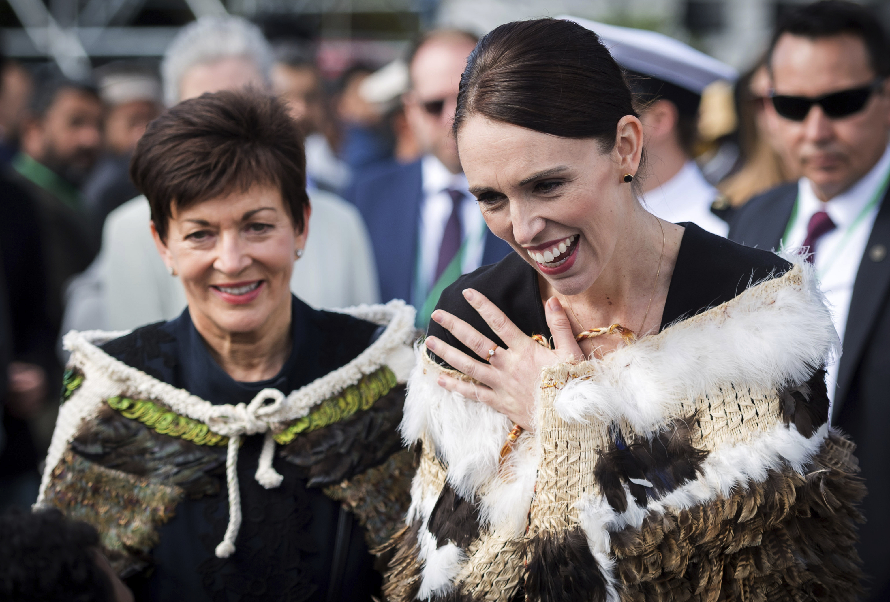 In this image supplied by the New Zealand government, New Zealand Prime Minister Jacinda Ardern, right, reacts as she meets members of the Muslim community following the national remembrance service for the victims of the March 15 mosques terrorist attack at Hagley Park in Christchurch, New Zealand, Friday, March 29, 2019. (Mark Tantrum via AP)