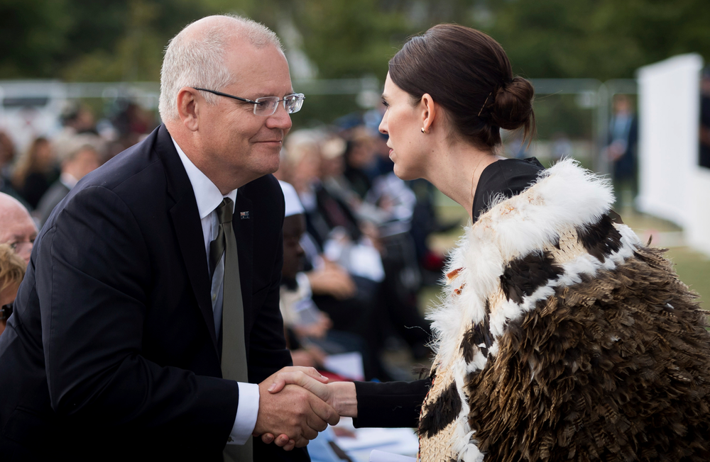 In this photo supplied by the New Zealand government, New Zealand Prime Minister Jacinda Ardern, right, meets Australian Prime Minister Scott Morrison during the national remembrance service for the victims of the March 15 mosques terrorist attack in Hagley Park, Christchurch, New Zealand, Friday, March 29, 2019. (Mark Tantrum/New Zealand Government via AP)