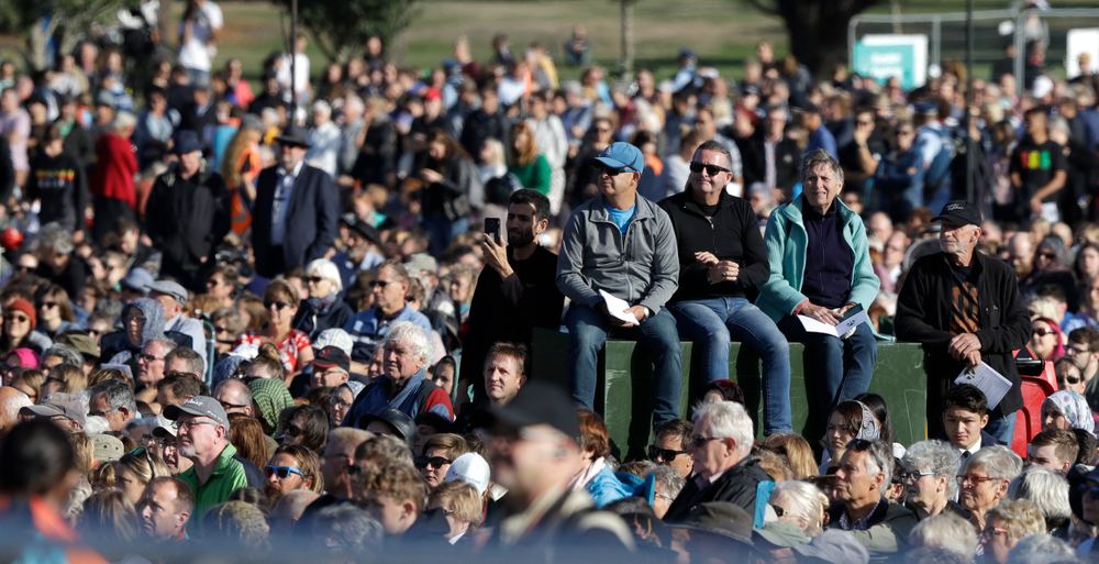 People listen during a National Remembrance Service in Hagley Park for the victims of the March 15 mosques terrorist attack in Christchurch, New Zealand, Friday, March 29, 2019. (AP Photo/Mark Baker)