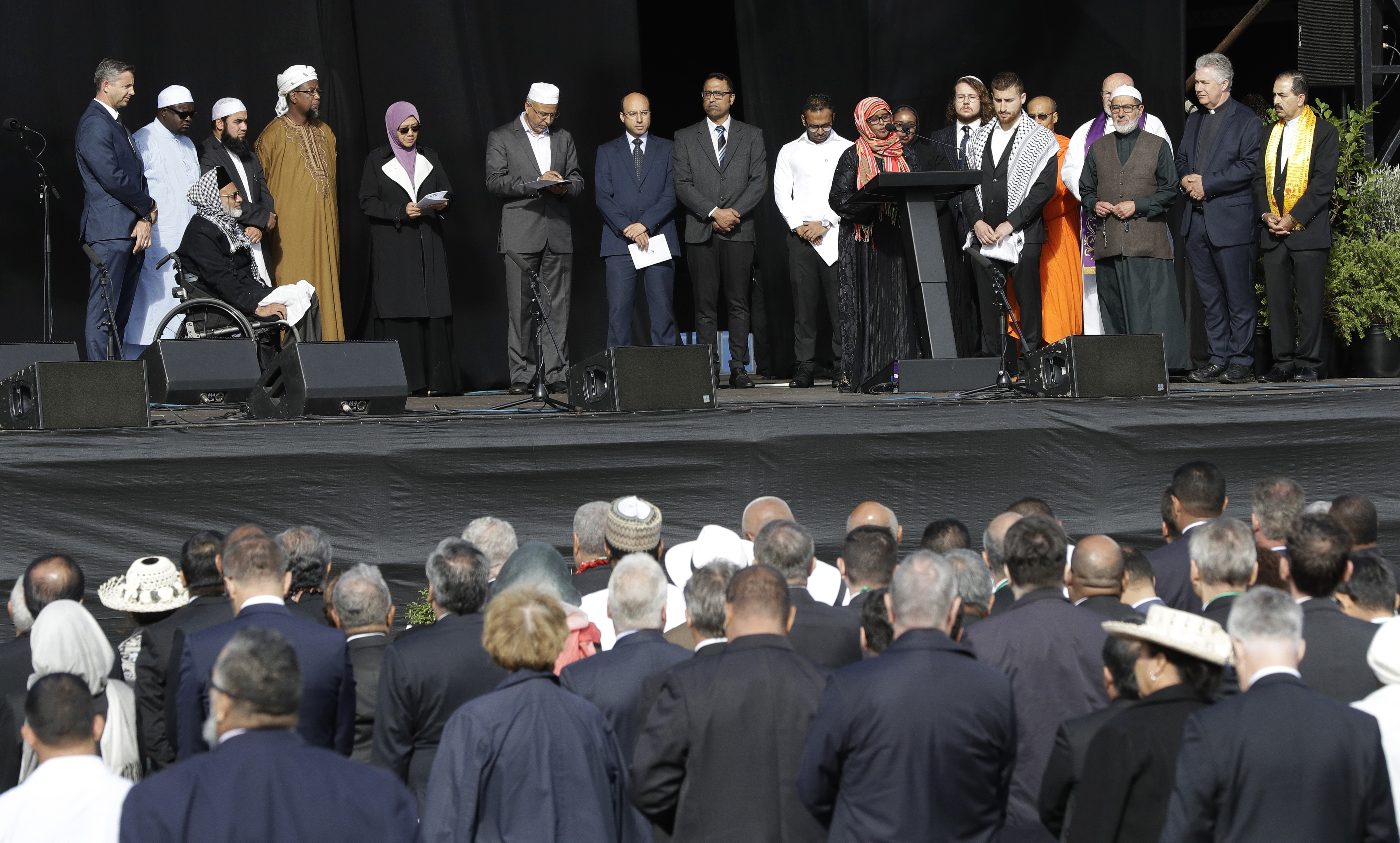 Members of the Christchurch Muslim community read the names of the dead during a national remembrance service for the victims of the March 15 mosques terrorist attack in Christchurch, New Zealand, Friday, March 29, 2019. (AP Photo/Mark Baker)