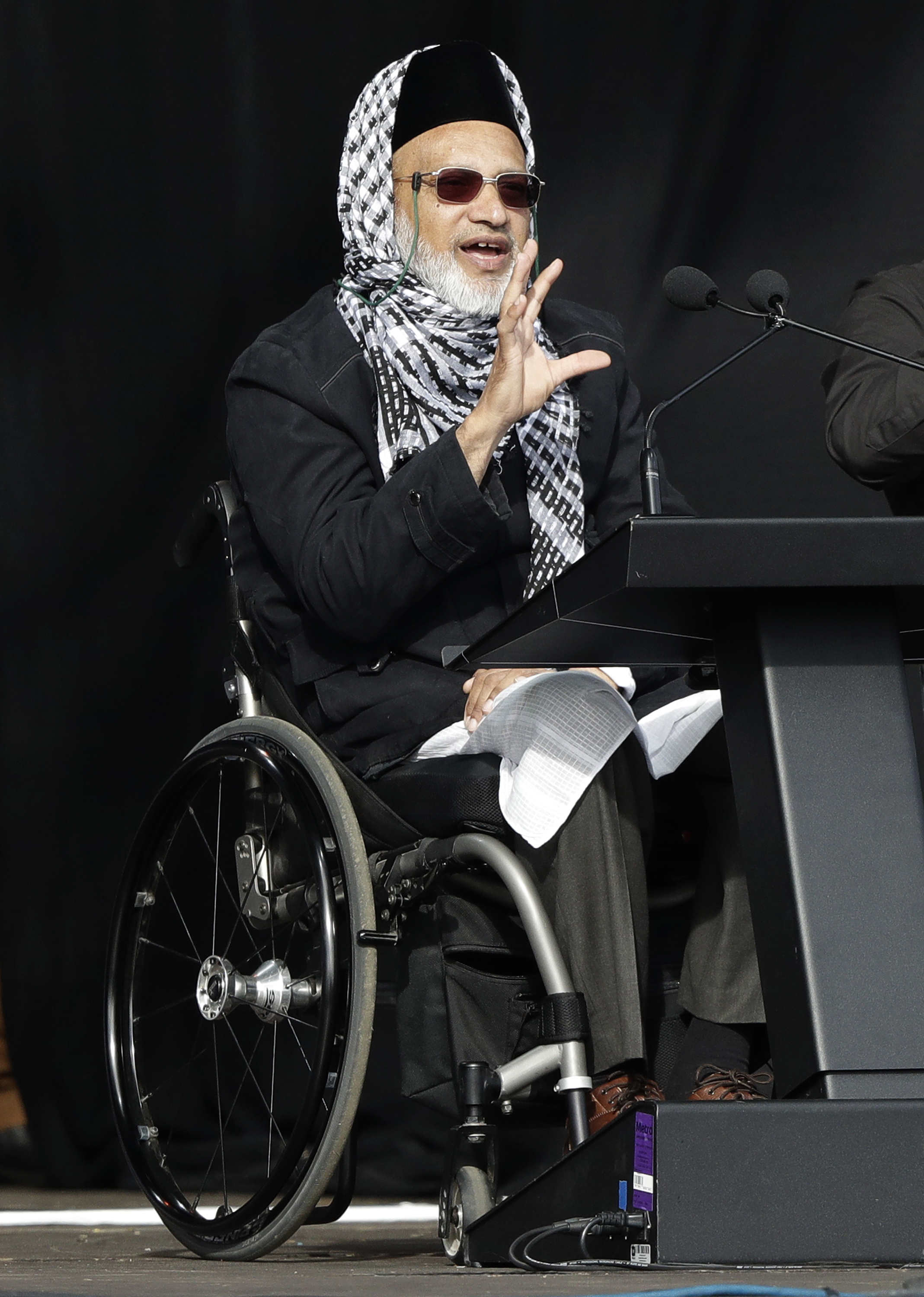 Mosque shooting survivor Farid Ahmed addresses the national remembrance service at Hagley Park for the victims of the March 15 mosques terrorist attack in Christchurch, New Zealand, Friday, March 29, 2019. (AP Photo/Mark Baker)