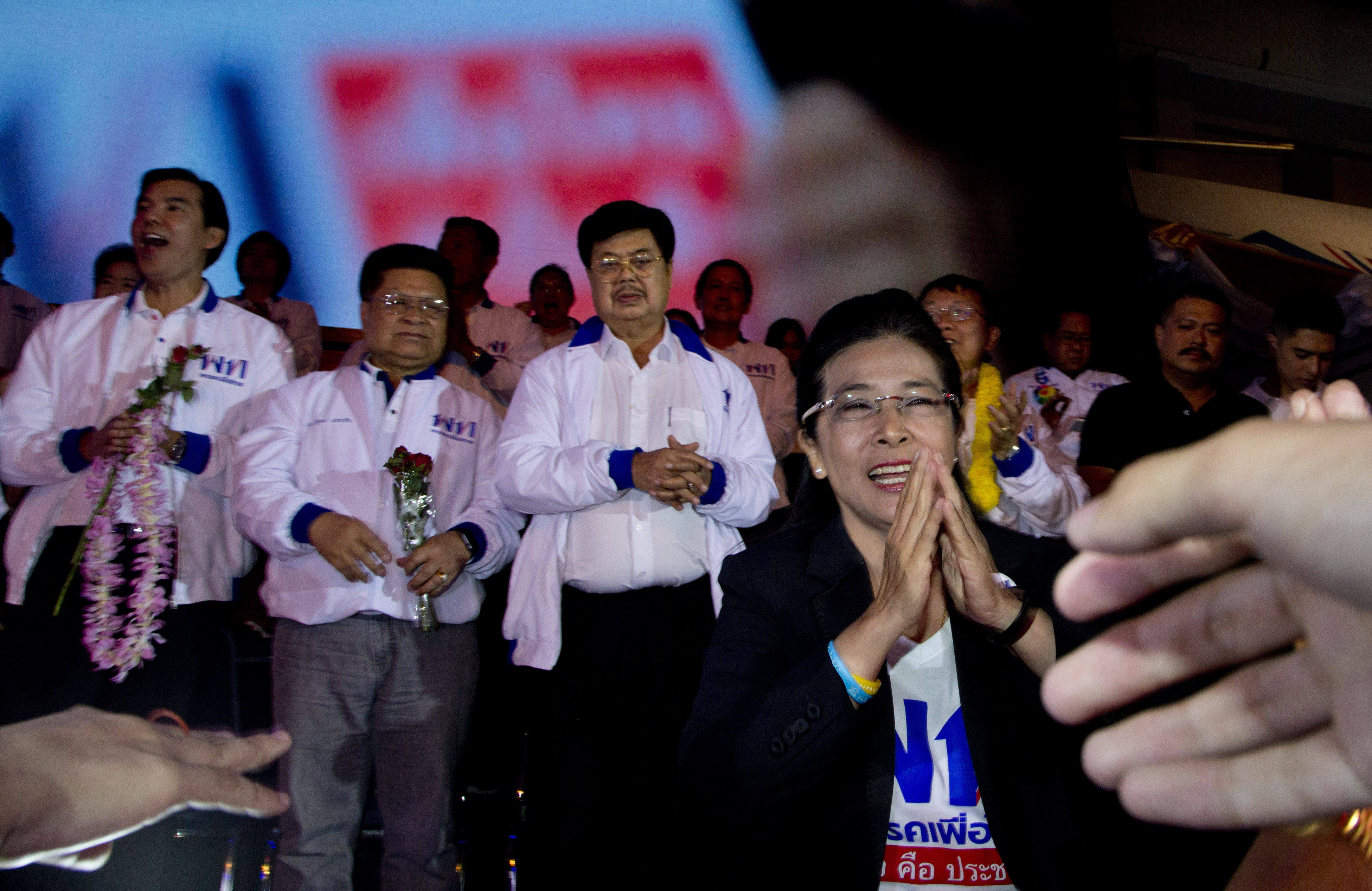 The leader of Pheu Thai Party and candidate for prime minister Sudarat Keyuraphan, right, gestures, during an election rally concluding their campaign ahead of general election in Bangkok, Thailand, Friday, March 22, 2019. The nation's first general election since the military seized power in a 2014 coup is scheduled to be held on March 24. (AP Photo/Gemunu Amarasinghe)