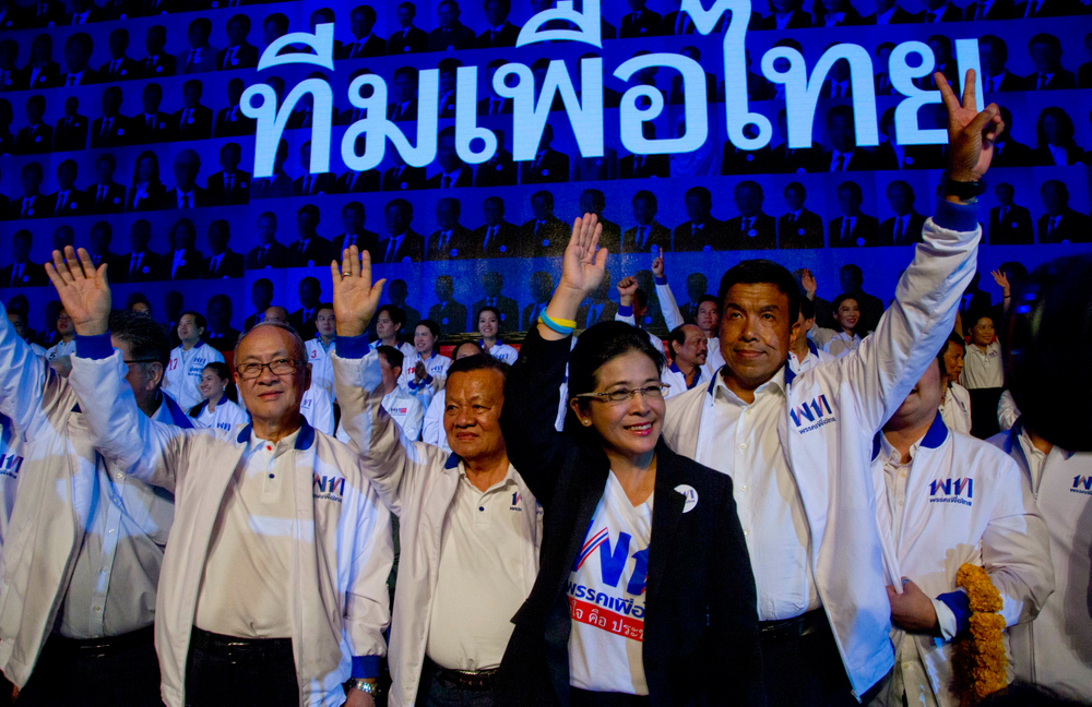 The leader of Pheu Thai Party and candidate for prime minister Sudarat Keyuraphan, second right, and contestants wave during an election rally of general elections in Bangkok, Thailand, Friday, March 22, 2019. The nation's first general election since the military seized power in a 2014 coup is scheduled to be held on March 24. (AP Photo/Gemunu Amarasinghe)