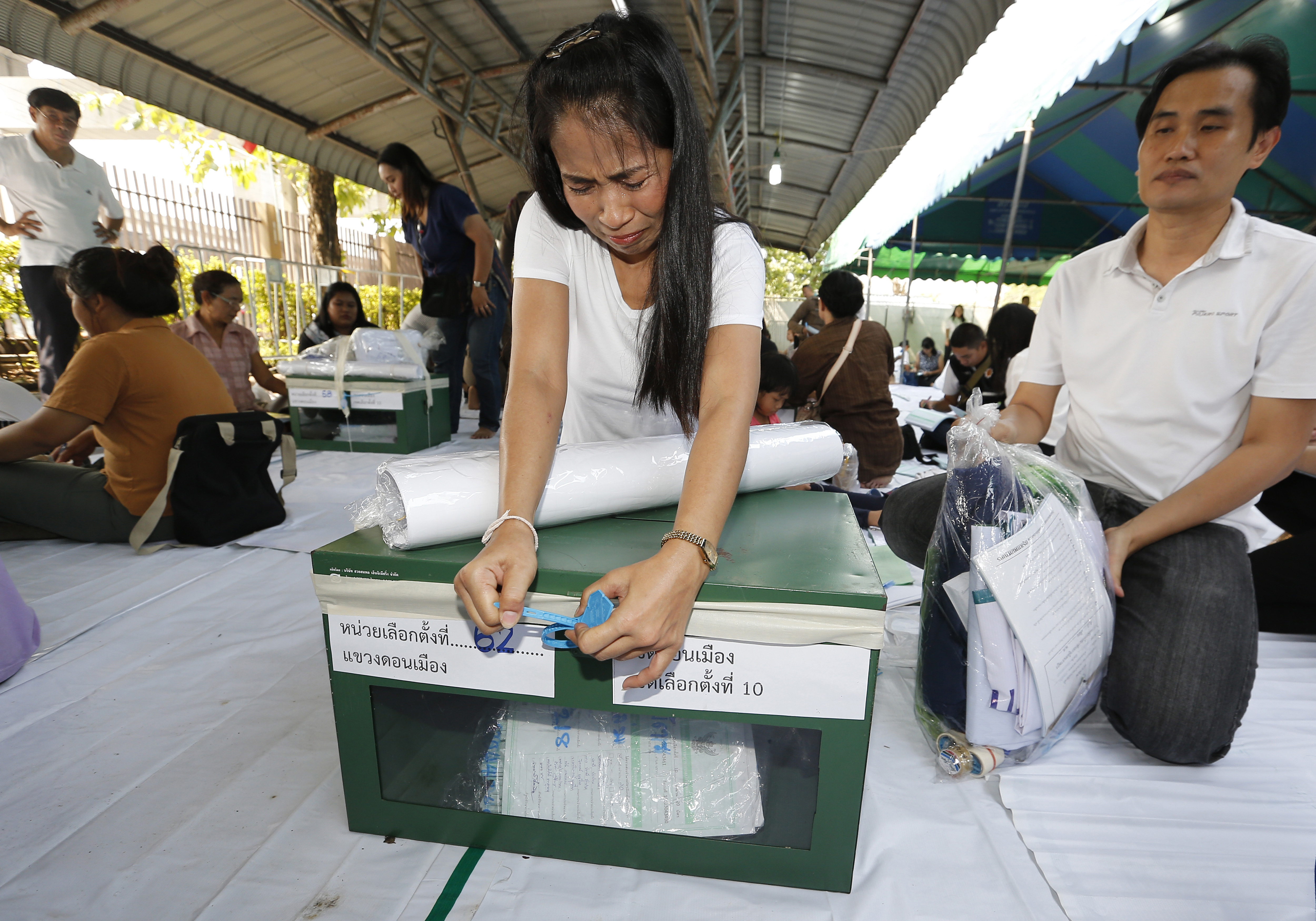Volunteers lock ballot boxes ahead of Sunday's general elections Bangkok, Thailand, Saturday, March 23, 2019. The nation's first general election since the military seized power in a 2014 coup is scheduled to be held on March 24. (AP Photo/Sakchai Lalit)