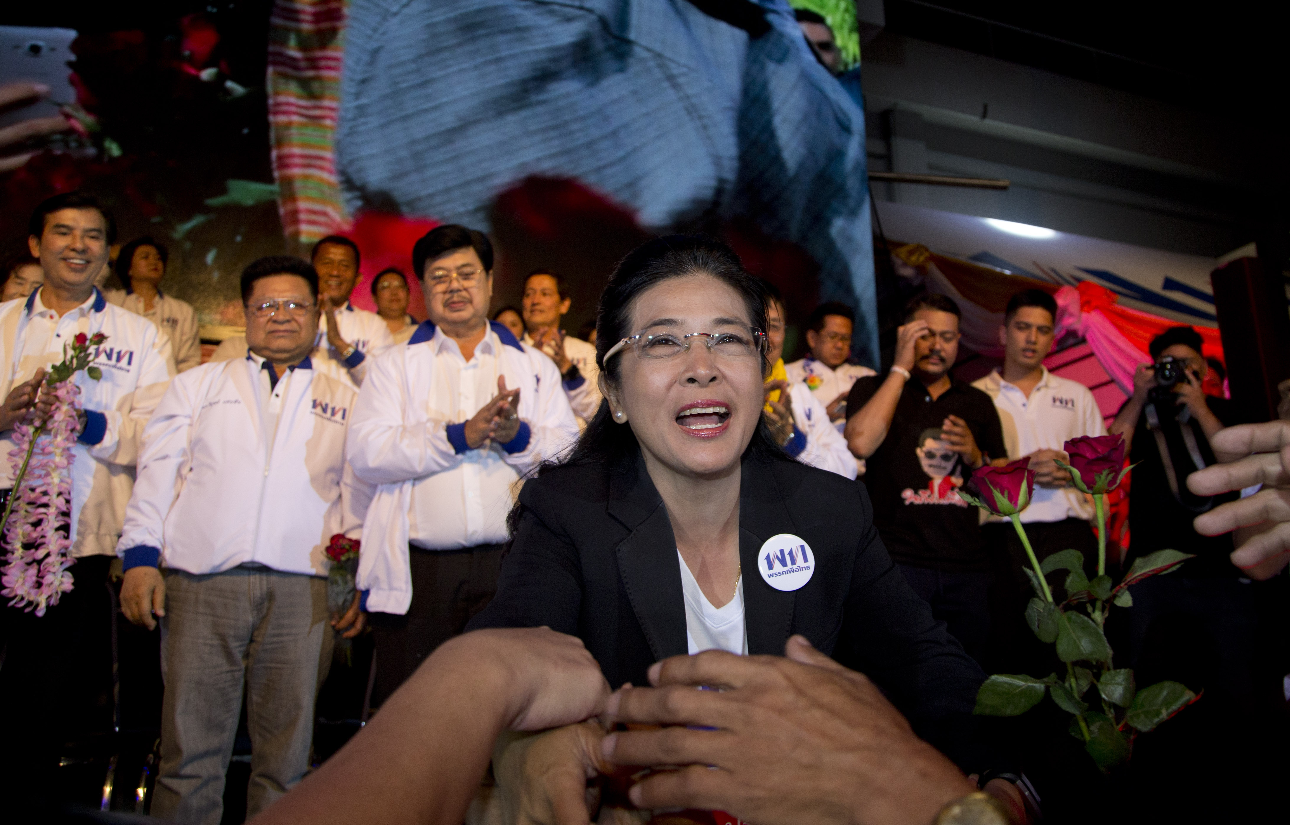 The leader of Pheu Thai Party and candidate for prime minister Sudarat Keyuraphan reaches to shake hands of supporters during an election rally concluding their campaign ahead of general election in Bangkok, Thailand, Friday, March 22, 2019. The nation's first general election since the military seized power in a 2014 coup is scheduled to be held on March 24. (AP Photo/Gemunu Amarasinghe)