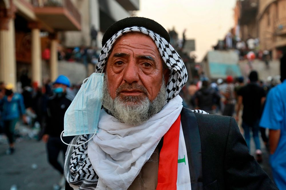 An elderly man takes part in anti-government protesters at the historic Rasheed Street in Baghdad, Iraq, Sunday, Nov. 24, 2019. At least 342 people have died since demonstrations began Oct. 1, when thousands of Iraqis, mostly youth, took to the streets to decry corruption and poor services. The leaderless uprising seeks to overthrow the political establishment. (AP Photo/Khalid Mohammed)