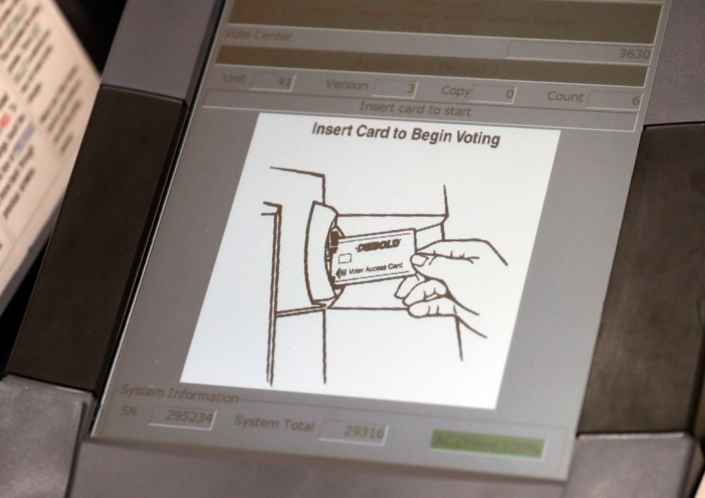 FILE - This May 9, 2018, photo shows a touch screen of a voting machine during early voting in Sandy Springs, Ga. New voting machines that combine touchscreens with paper ballots are getting a limited test run in Georgia. It's part of an effort to meet a court-ordered deadline to retire the old touchscreen only system before any votes are cast in 2020. (AP Photo/John Bazemore, File)