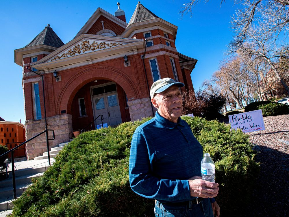 Temple president Michael Atlas-Acuña found signs, flowers and candles expressing love for the Jewish community when he arrived at the historic Temple Emanuel in Pueblo, Colo., Tuesday morning, Nov. 5, 2019. Richard Holzer, 27, of Pueblo was arrested Friday by the FBI after he allegedly said he was going to go blow up the temple because he hates Jews. (Christian Murdock/The Gazette via AP)
