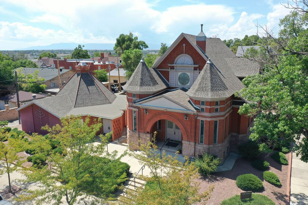 FILE - This Aug. 22, 2019 file photograph shows an aerial view of Temple Emanuel in Pueblo, Colo. The synagogue is planning to add surveillance cameras to enhance its already tight security following the arrest of a man accused of plotting to bomb it.  (Zachary Allen/The Pueblo Chieftain file via AP, File)