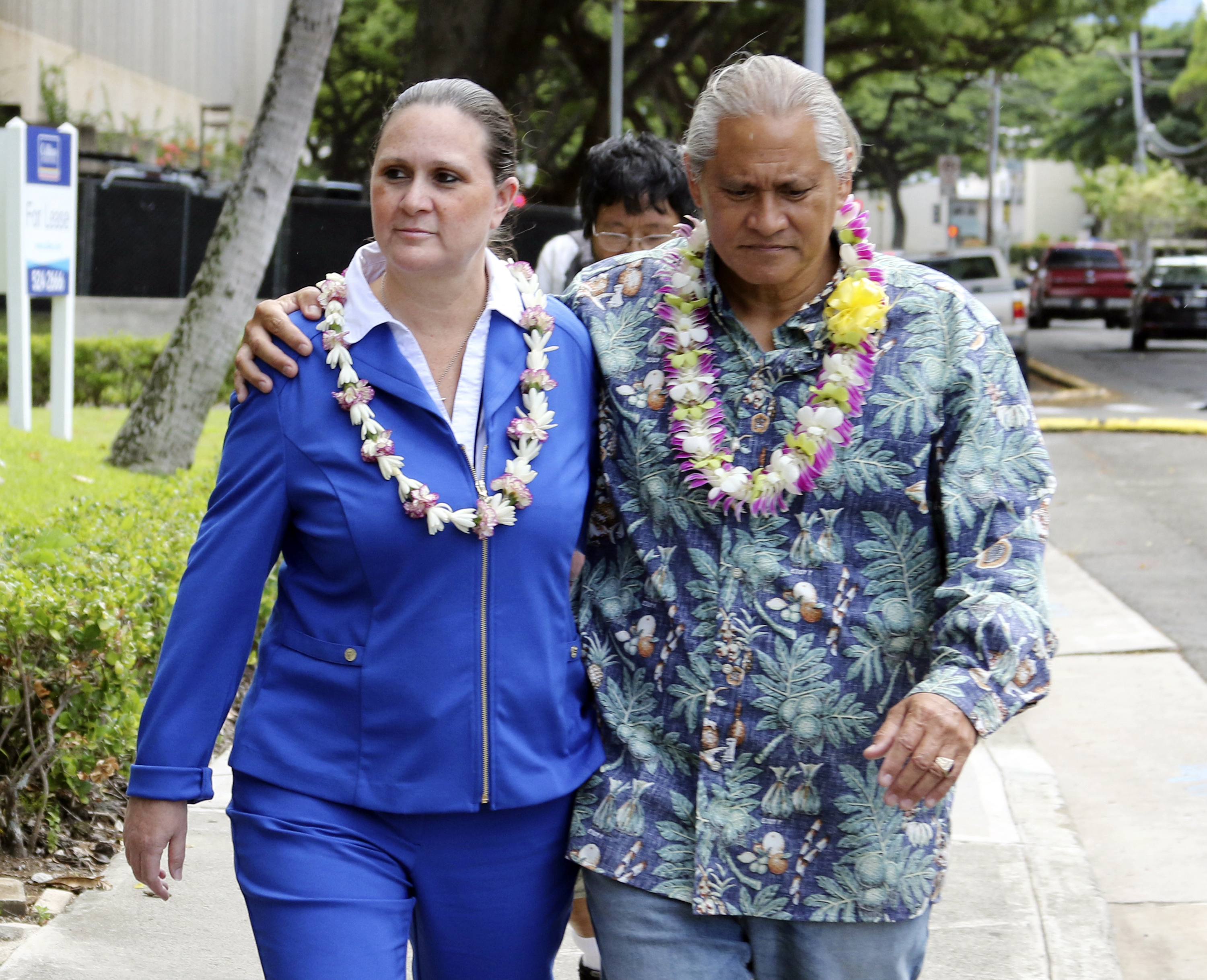 FILE - In this Oct. 20, 2017 file photo, former Honolulu Police Chief Louis Kealoha and his wife Katherine Keahola leave federal court in Honolulu. The city of Honolulu's chief legal officer has received a target letter linked to an ongoing federal corruption investigation. Mayor Kirk Caldwell says Corporation Counsel Donna Leong is taking a paid leave of absence, effective Monday, Jan. 14, 2019. (AP Photo/Caleb Jones, File)