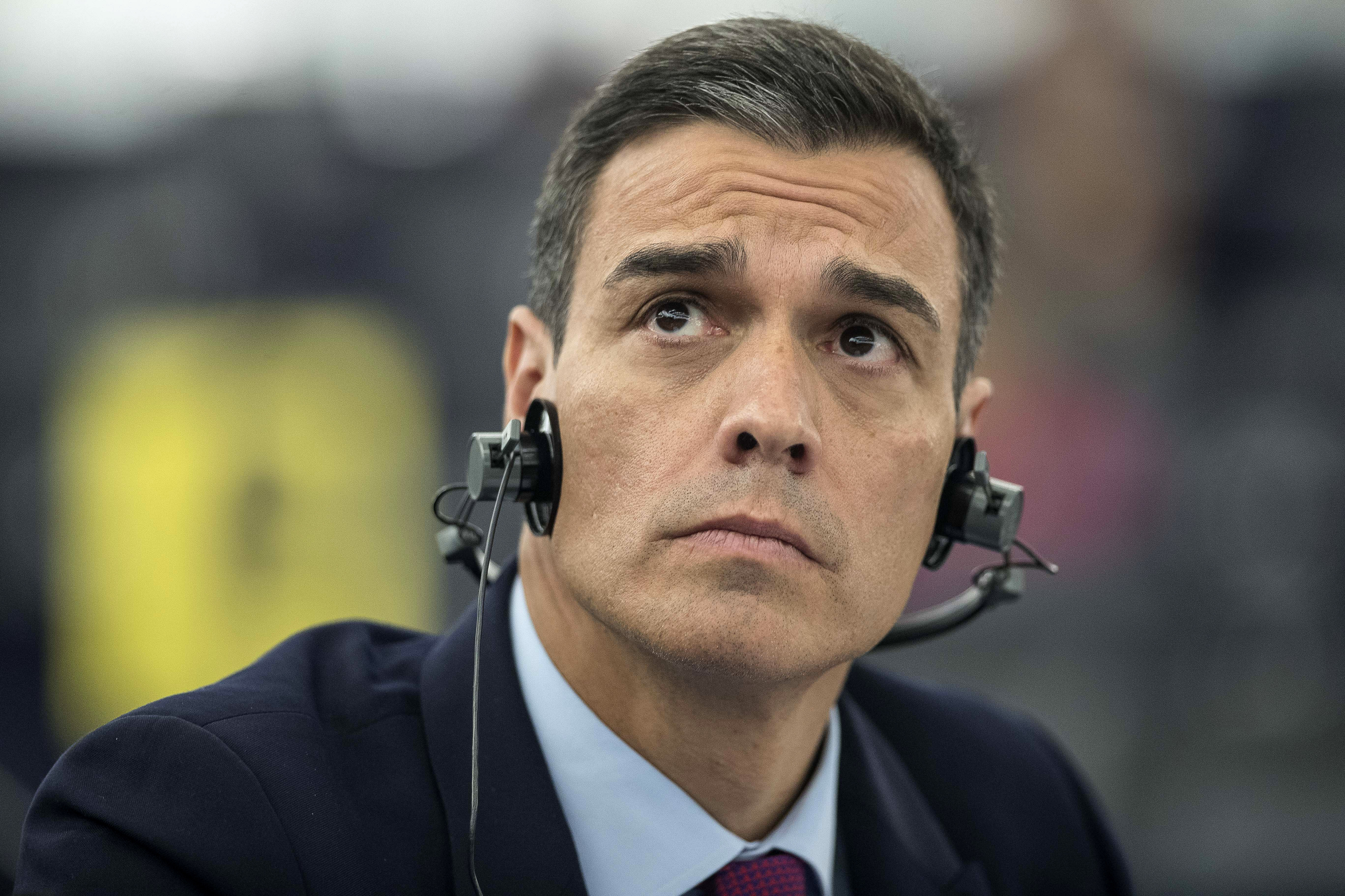 FILE - In this Jan.16, 2019 file photo, Spanish Prime Minister Pedro Sanchez listens during a debate on the future of Europe at the European Parliament in Strasbourg, eastern France. During a visit to the national institute for cybersecurity in Leon in Spain on Tuesday April 9, 2019, Sanchez said that whoever wins the upcoming general election in Spain should launch a national cybersecurity plan to fight attempts to undermine democracy and citizens' trust in the political system. (AP Photo/Jean-Francois Badias, File)