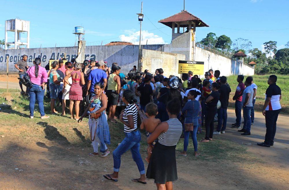 People seek information about family members who are prisoners after a riot inside the Regional Recovery Center in Altamira, Brazil, Monday, July 29, 2019. At least 57 prisoners were killed by other inmates during clashes between organized crime groups in the Altamira prison in northern Brazil Monday with 16 of the victims being decapitated, according to prison officials. (Wilson Soares/Panamazonica via AP)