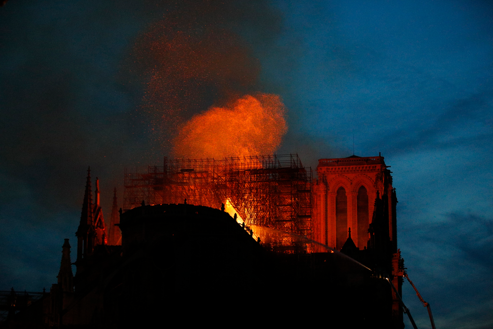 Firefighters use hoses as Notre Dame cathedral burns in Paris, Monday, April 15, 2019. A catastrophic fire engulfed the upper reaches of Paris' soaring Notre Dame Cathedral as it was undergoing renovations Monday, threatening one of the greatest architectural treasures of the Western world as tourists and Parisians looked on aghast from the streets below. (AP Photo/Francois Mori)