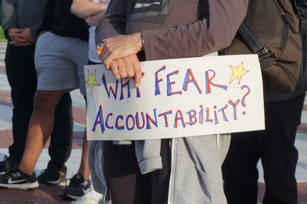 A protest sign held during the demonstration.