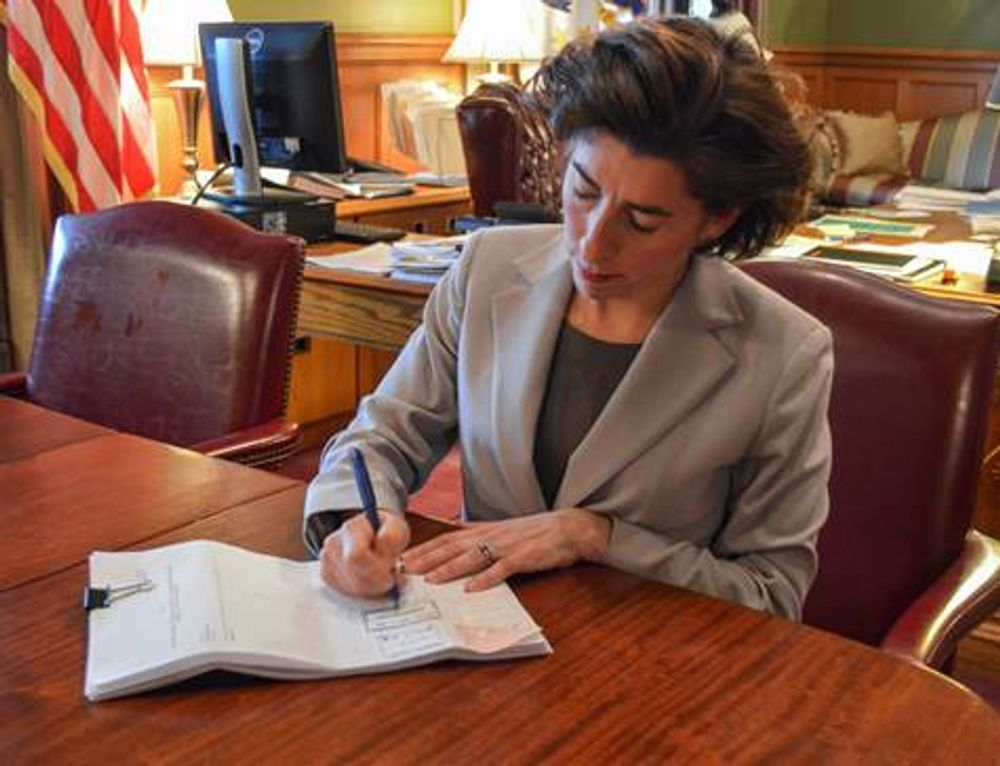 Governor Gina Raimondo signing legislation that enabled Twin River's Tiverton casio. Raimondo supports a no-bid contract extension for IGT