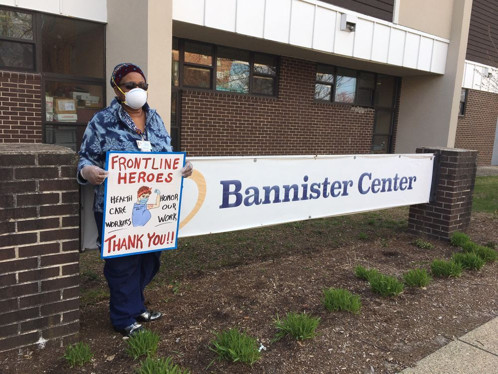 A worker protests outside Bannister Center in Providence.