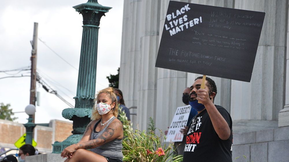 Julius Dunn, right, is pictured at a Black Lives Matter protest in Westerly on Sunday, Aug. 2, 2020. Rana Hamelin is seated at left.