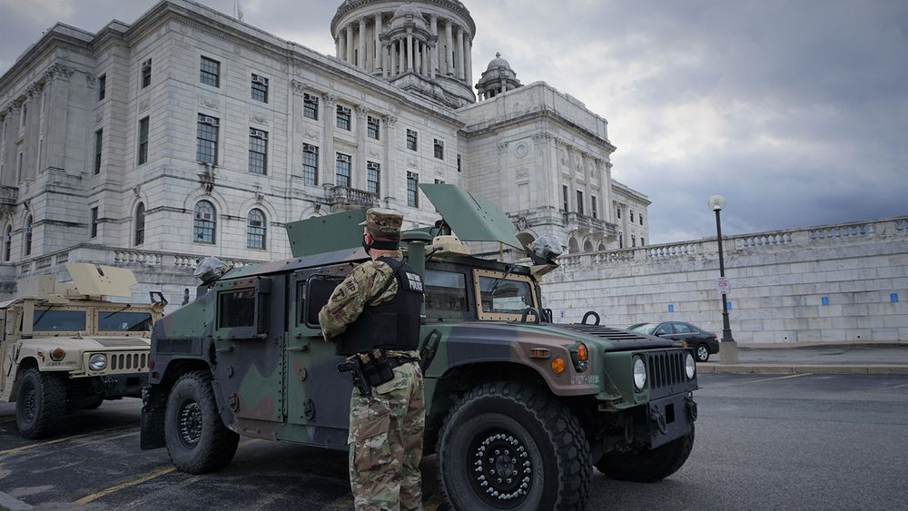 National Guard troops position themselves outside of the statehouse in Providence in preparation for Inauguration Day