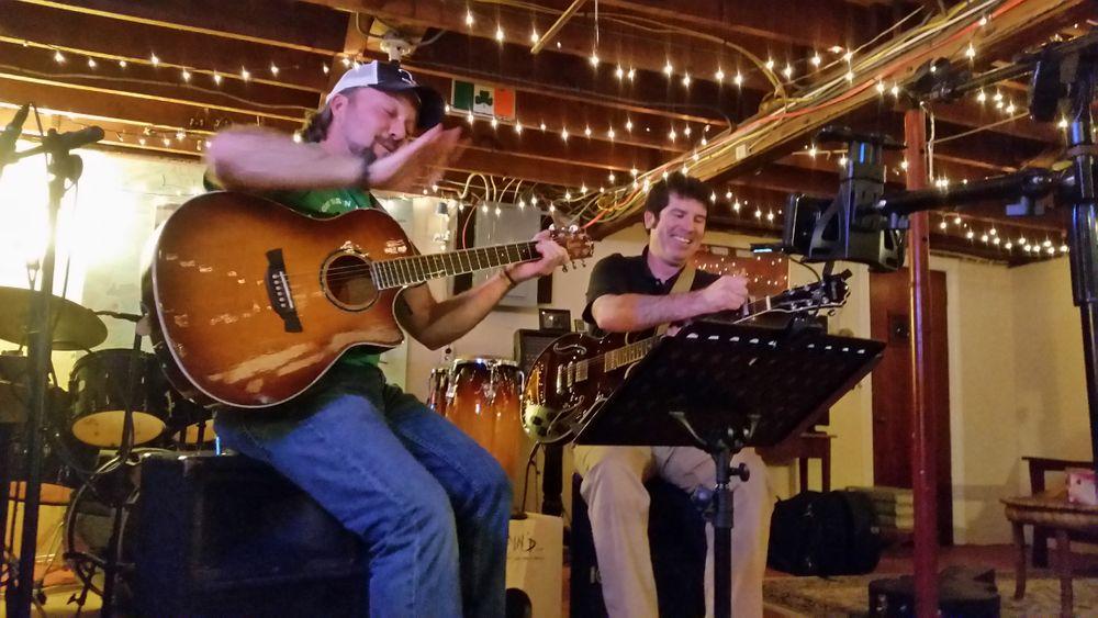Pat Kirker and Tom Foley play Irish folk songs on St. Patrick's Day.