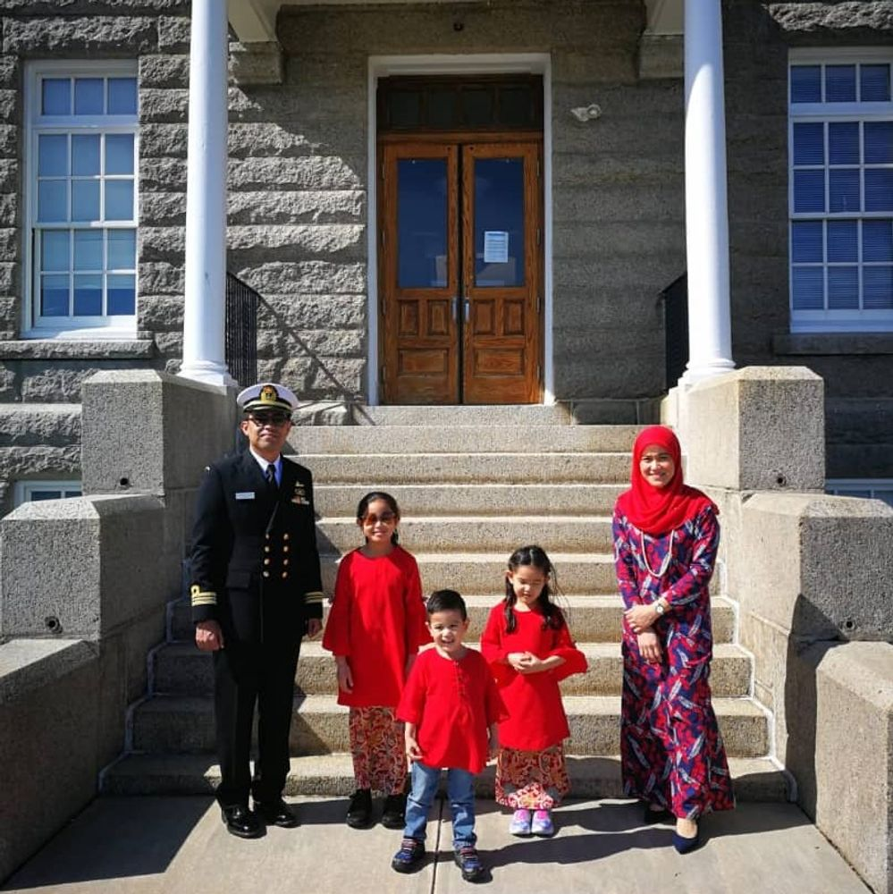 Faiz Zanila and his family outside Luce Hall, a building at the Naval War College.