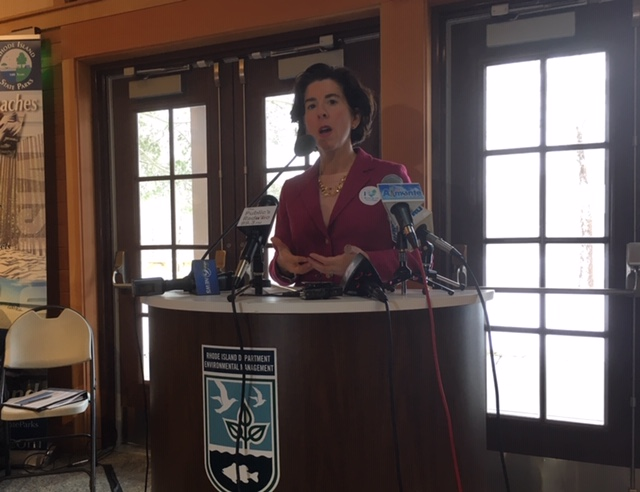 Raimondo speaks during a news conference at Lincoln Woods.