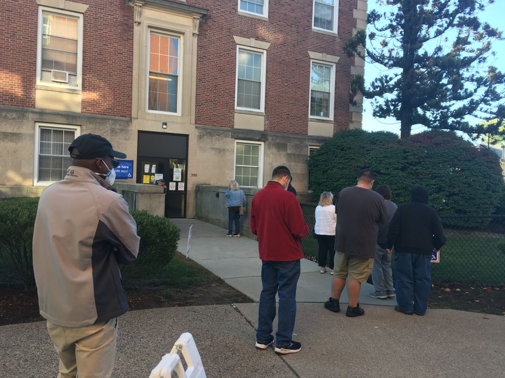 Voters wait outside Cranston City Hall Wednesday morning.