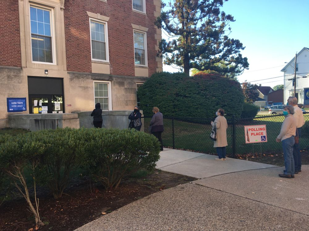 Cranston voters line up to cast ballots, as early voting begins in RI
