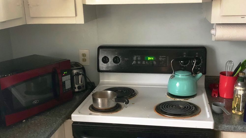 Kitchen with an electric stove and microwave-- two appliances tested for their energy usage