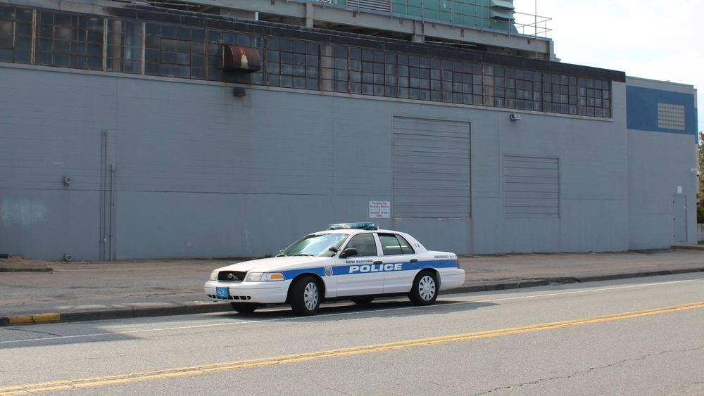New Bedford police keep an eye on the picket line all day.