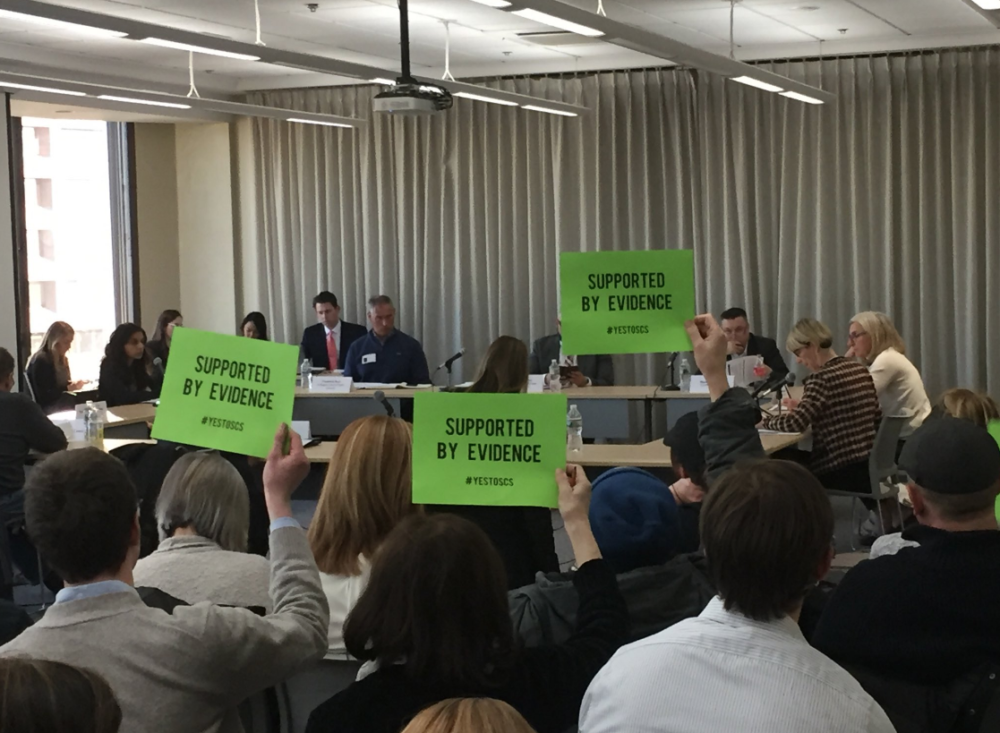 Although public comments were not allowed during Tuesday's special commission meeting on supervised consumption sites, supporters found a way to weigh in.