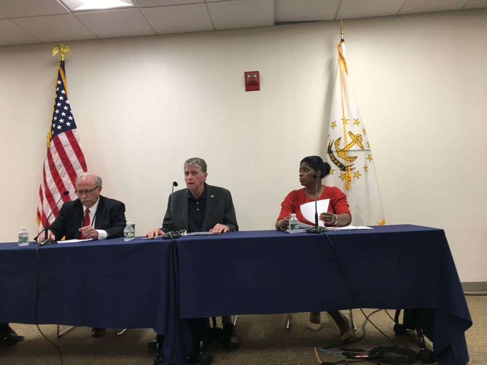 EOHHS Secretary Womazetta Jones (right) speaks at a news conference with Gov. Dan McKee (center) and BHDDH director Richard Charest (left)