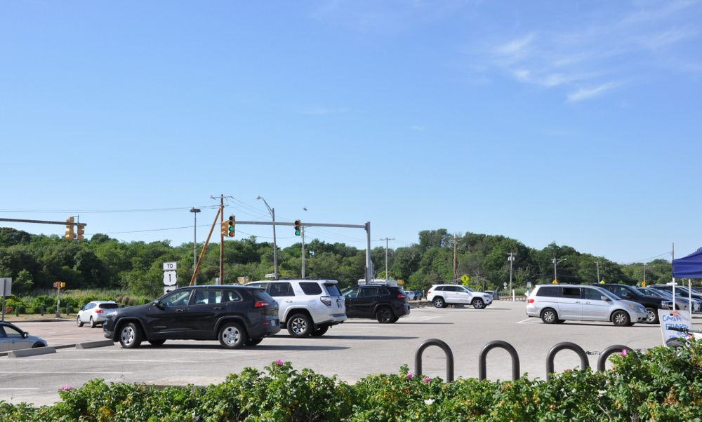 Empty spaces are seen at the Narragansett Town Beach parking lot.