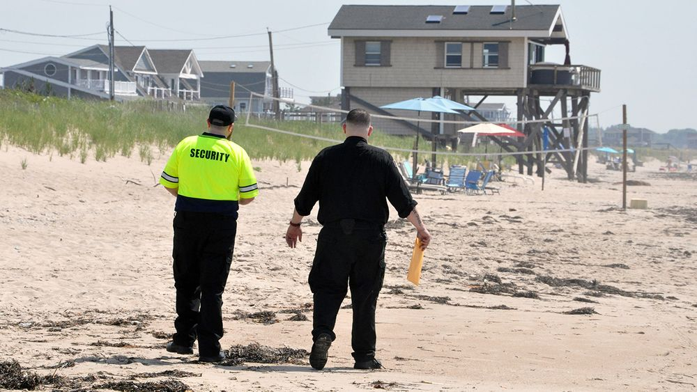 Private security guards patrol the beach near the line between Charlestown Town Beach and South Kingstown on June 27, 2020.
