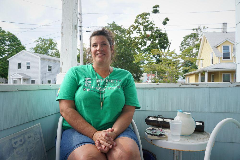 Kristin Emmett on her front porch in East Providence
