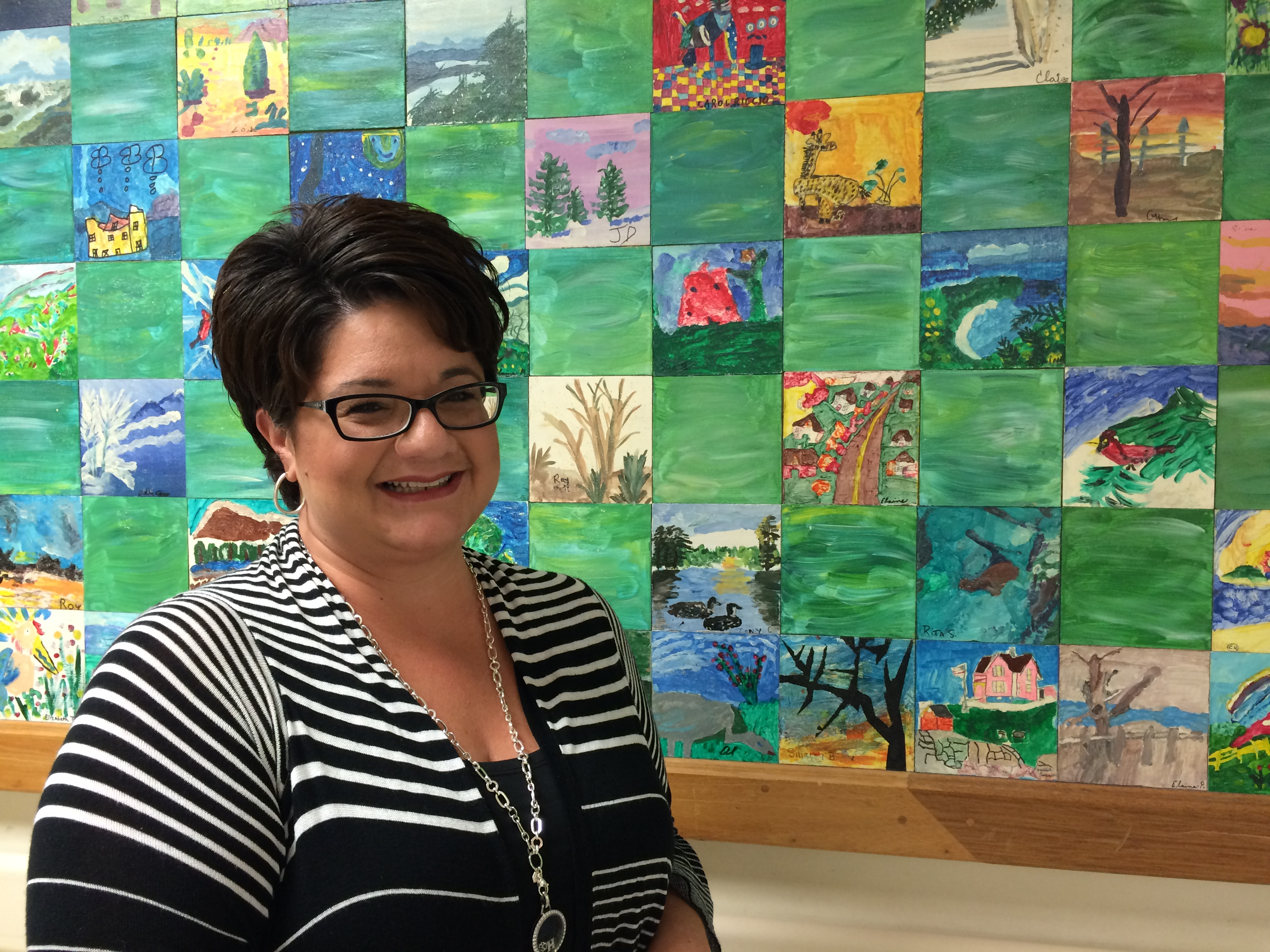 Jennifer McCarthy, a hospital administrator, leads a tour, starting in the main corridor near this patient mural.